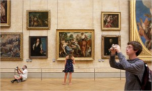 Visitors at the Louvre: some engage directly with the art while others take pictures of pictures. Valerio Mezzanotti for The New York Times
